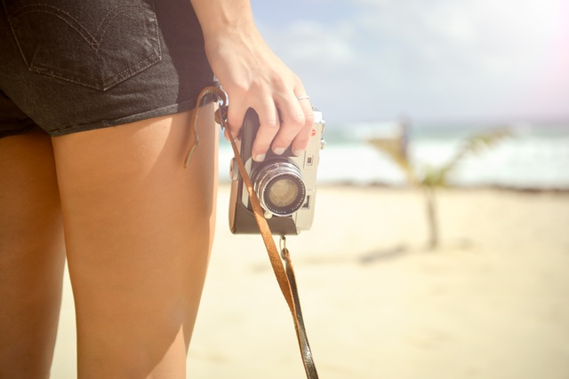 capturing memories, woman holding a camera, picture taking