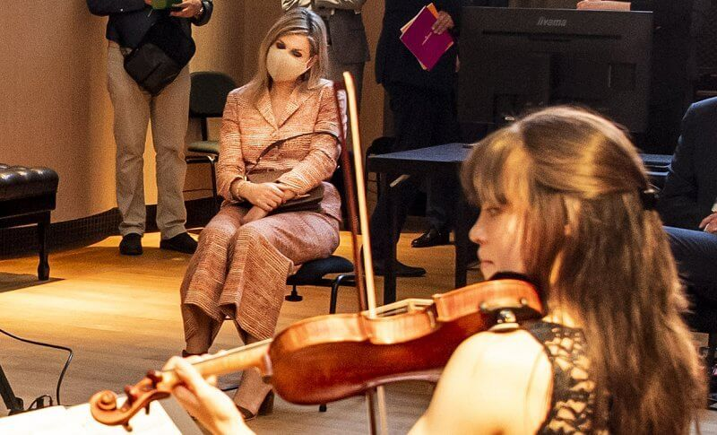 Royal Concertgebouw Orchestra in Amsterdam. Queen Maxima wore a pantsuit orange wool tweed jacket blazer and trousers from Natan
