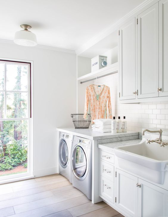 Beautiful modern farmhouse style white laundry room (Giannetti Home) inspiration on Hello Lovely Studio