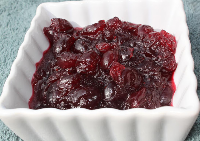 this is a holiday cranberry sauce with Amaretto. It's in a white ramekin dish and whole berries that were cooked fresh is in it