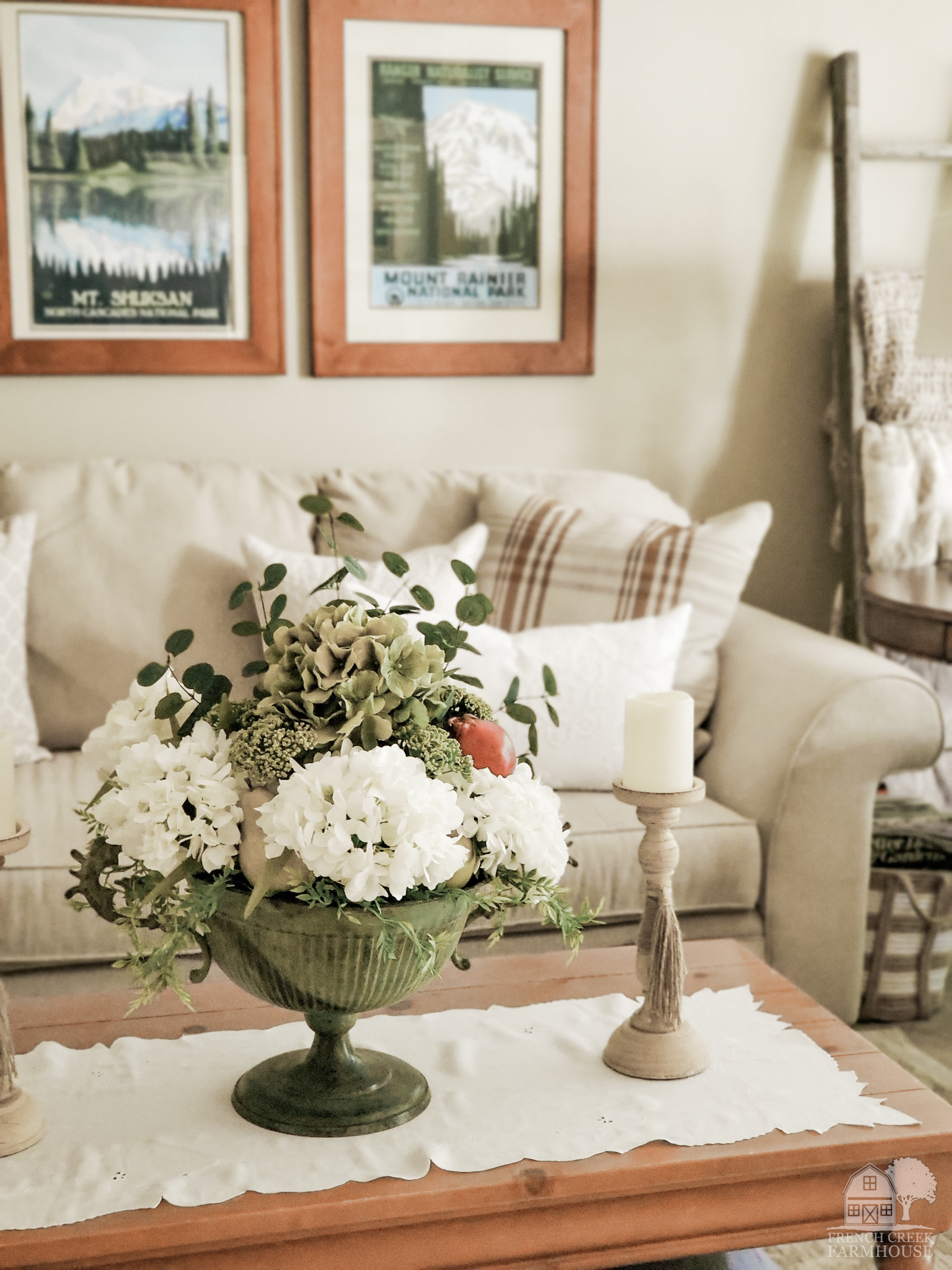 Cozy pillows and fall florals decorate our living room