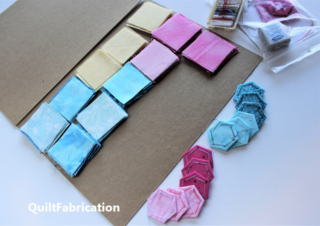 fabric squares between cardboard to prevent wrinkling