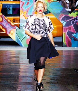 Rita Ora : all smiles , she has not scrolled for DKNY !