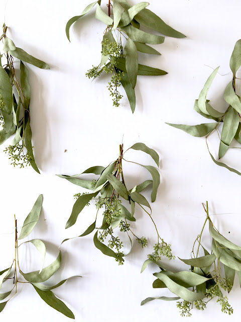 DIY Christmas wreath with cowbells olive leaf and eucalyptus