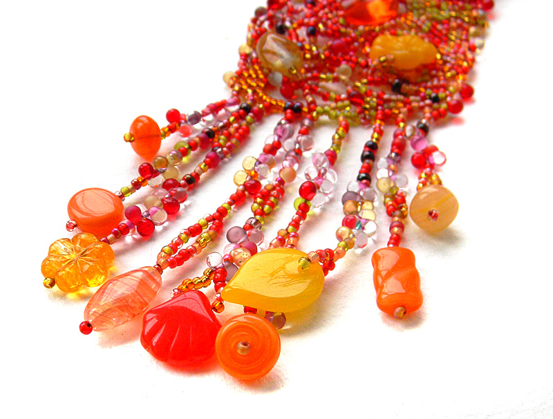 "Red, Orange, Yellow boho necklace - freeform beaded jewelry - bohemian necklace  -OOAK Red, Orange, Yellow boho necklace - freeform beaded jewelry - bohemian necklace  -OOAK Red, Orange, Yellow boho necklace - freeform beaded jewelry - bohemian necklace  -OOAK Red, Orange, Yellow boho necklace - freeform beaded jewelry - bohemian necklace  -OOAK Red, Orange, Yellow boho necklace - freeform beaded jewelry - bohemian necklace  -OOAK 🔎zoom Item Details        (157)   Shipping & Policies Beautiful beadwoven necklace in autumn (red, orange, yellow) tones.  My original design. Free form peyote. Boho / Bohemian style.   Necklace length (around the neck) - approx 58 cm ( 22.9"") Pendant size - 5 cm (2"") / 16 cm (6.3"") Red, Orange, Yellow boho necklace - freeform beaded jewelry - bohemian necklace -OOAK"