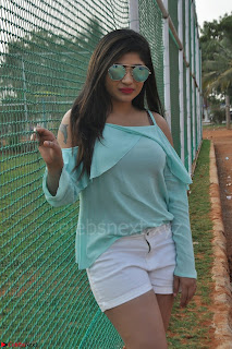 Madhulagna Das looks super cute in White Shorts and Transparent Top 09.JPG