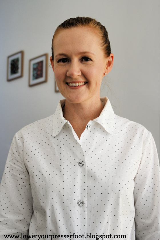 a lady wearing a white and black polka dot shirt