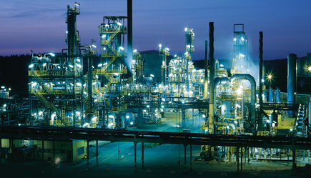 process plant with lights on at dawn