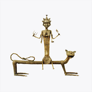 A Dokra idol of the tiger-riding, trishul wielding goddess Danteshwari Mata, who is worshiped by the Gond tribes of Chhasttigarh.