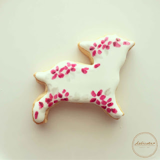 sheep cookies painted with rose in natural food colouring