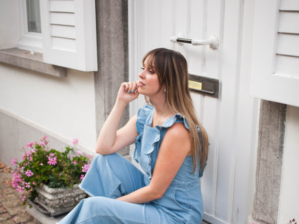 Outfit: ruffled jumpsuit, gold loafer pumps