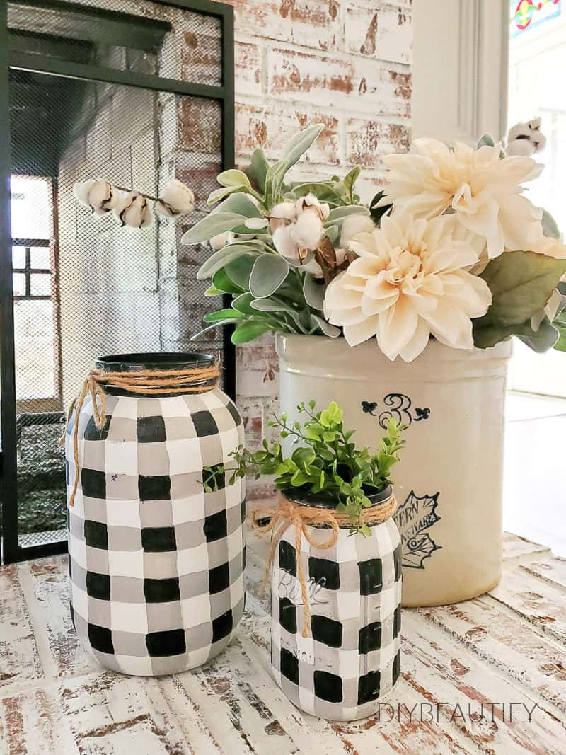 buffalo check mason jars on painted fireplace
