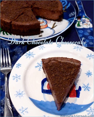 Dark Chocolate Cheesecake, a chocolate crust is filled with a creamy dark chocolate cheesecake mixture, baked, then sprinkled with a little chocolate crumble. | Recipe developed by www.BakingInATornado.com | #recipe #chocolate