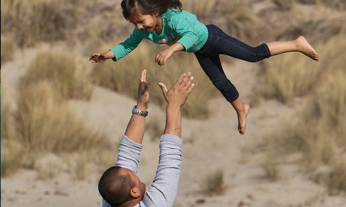 9 Little Things Every Father Must Give His Child,girl left up carry through in the air