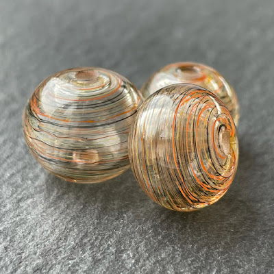 Handmade hollow lampwork glass beads made with CiM Bird's Nest