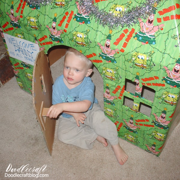 When our baby boy was 2, we couldn't afford gifts at all. We felt a little dejected as parents, but again, got creative. We found this giant box at my dad's house and convinced him to give it to us. Then my hubby and I cut a hinged door, open windows and a pitched roof. Then we wrapped it carefully in some wrapping paper we took from my in-laws.   It took us time, but no money. Guess what!? He was thrilled! He and all his cousins wanted to spend all Christmas morning playing in Danny's house--and didn't care about any other presents. It was wonderful--and the favorite gift of Christmas that year!