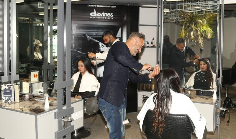 Experts demonstrating their skills of hair care during reopening of Looks Unisex Salon in Ludhiana today