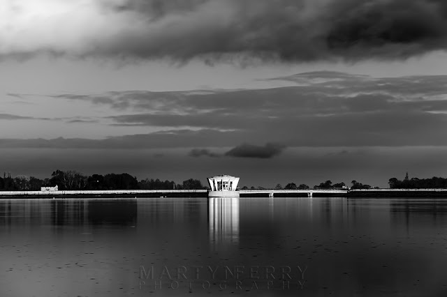 Sunshine plays on the pumping station at Grafham Water in this monochrome image
