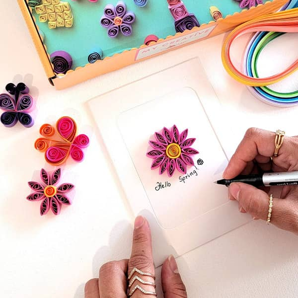 colorful quilled projects include flowers and butterflies