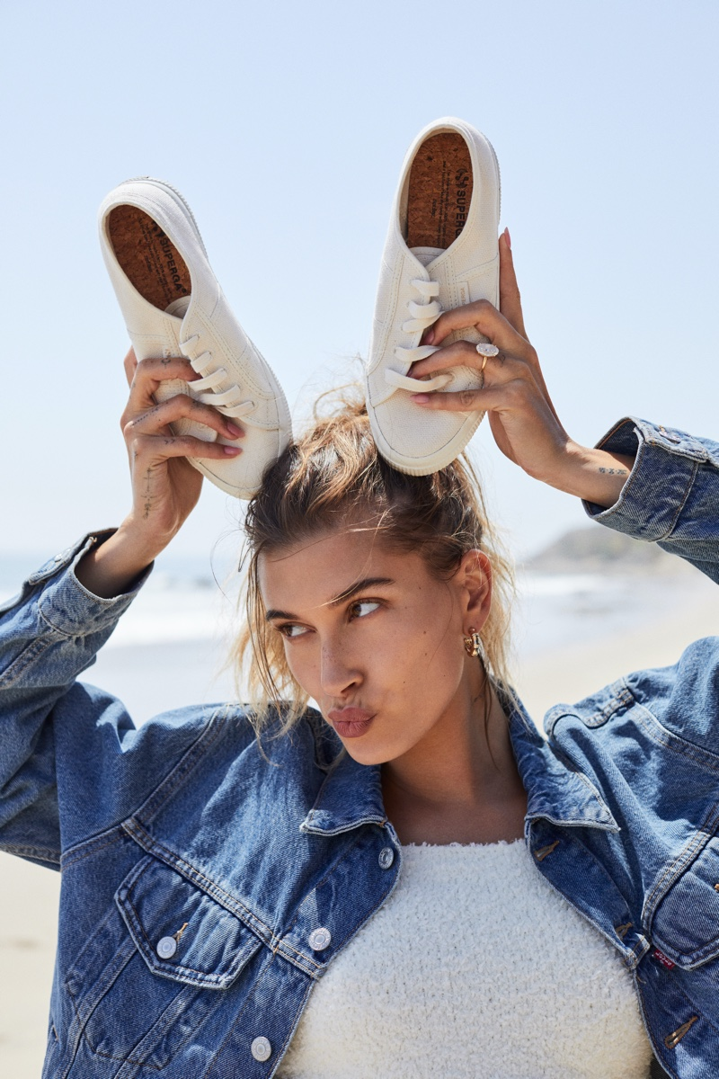 Making a bunny face, Hailey Bieber fronts Superga fall-winter 2021 campaign.