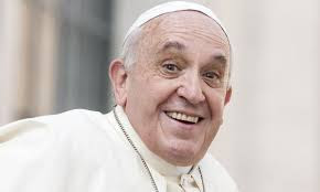 Pope grinning