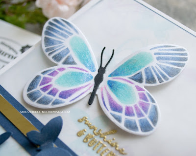 This fun card uses Concord & 9th's Butterfly Love stamps and dies.  The butterfly turnabout stamp created a fun background, that was softened with vellum, and allows the butterfly shaded in with colored pencils to be at the fore front.