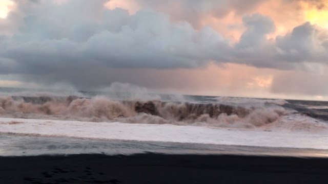 crashing waves at black sand beach
