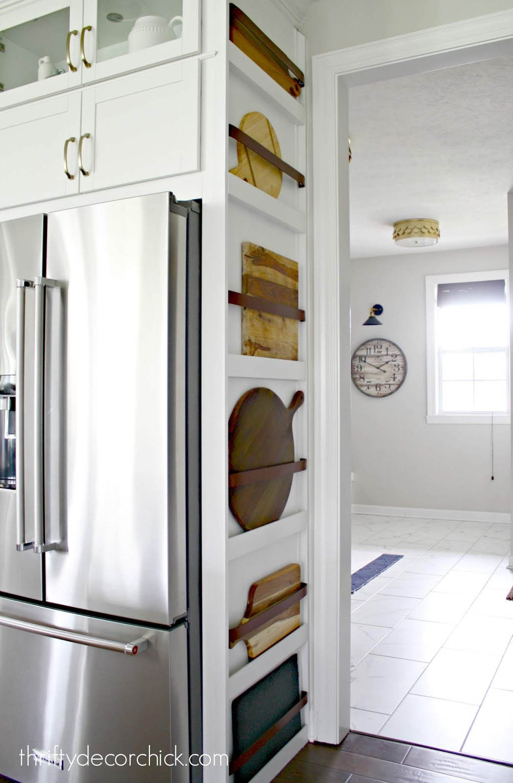 Use side of fridge for plate rack