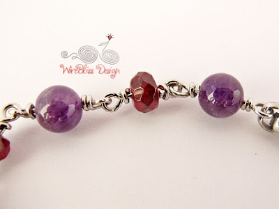 Close Up of Wire Wrapped Stainless Steel Minima Bracelet (Minlet) with Amethyst and Garnet