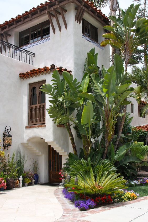 Beautiful facade adorned with luscious banana leaf  trees.