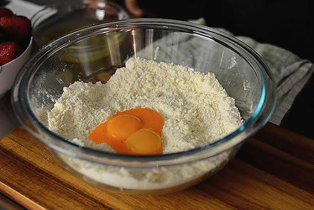 add egg yolk to Strawberry galette pastry