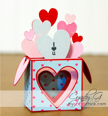 3d card with hearts coming out the top
