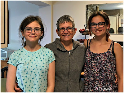 May 26, 2019 Standing with my granddaughters who are now taller than me.