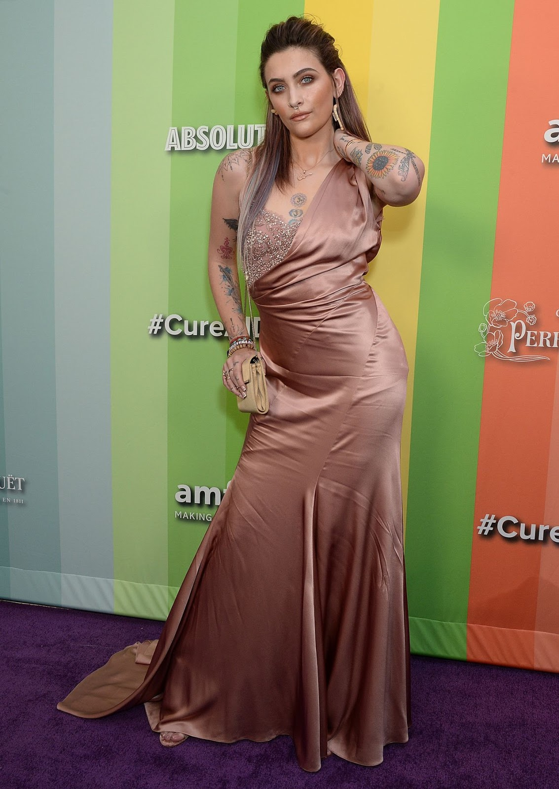 Paris Jackson dazzles in blush satin gown as she poses on the carpet at amFAR Gala