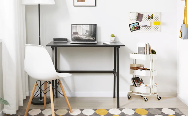 minimal office design set up with small wooden table and plastic chair