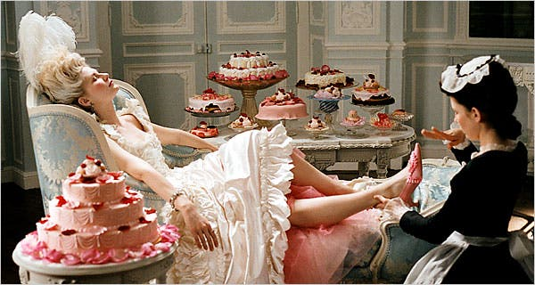 Marie Antoinette on chaise lounge let them eat cake