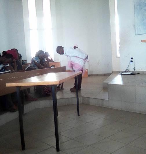 Aww! Lecturer backs a baby during exam invigilation in Ivory Coast