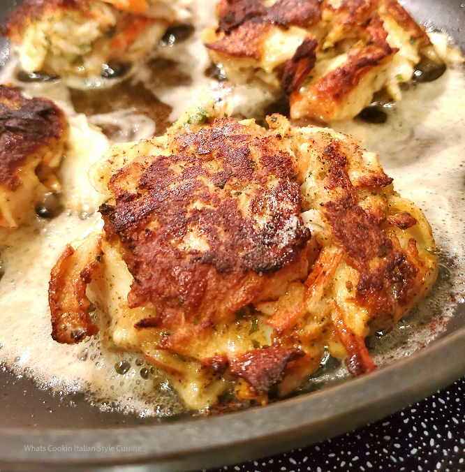 these are crab cakes frying in a pan of butter