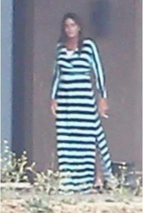Bruce Jenner rocks a long slit dres