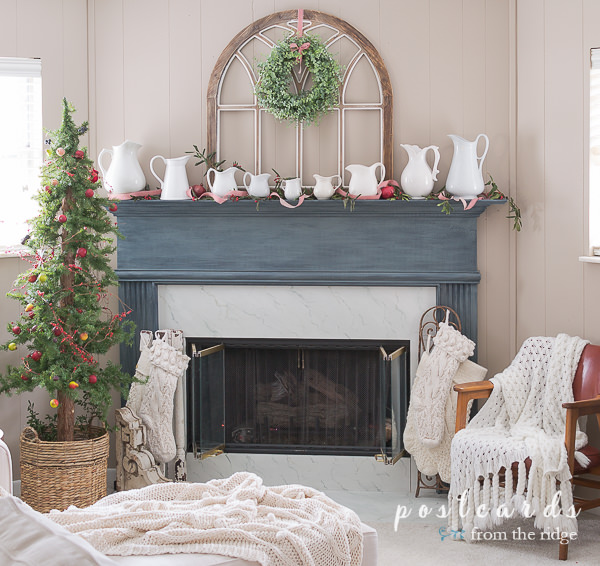 blue mantel with white ironstone pitchers and Christmas decor