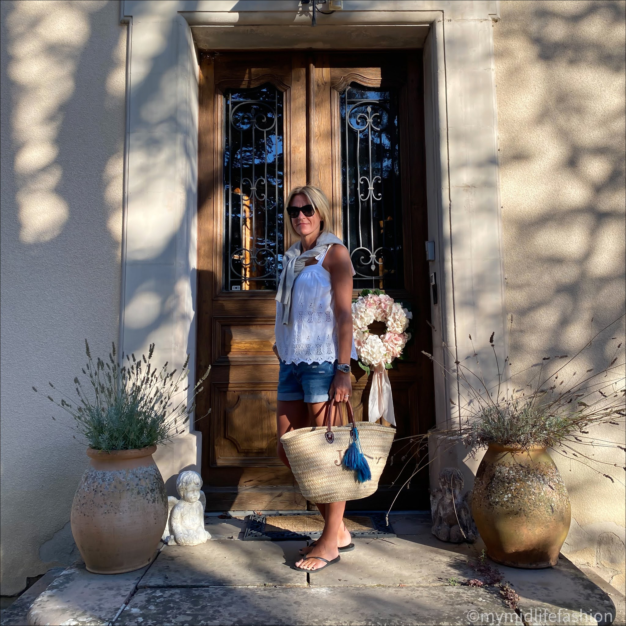 my midlife fashion, marks and Spencer pure cashmere round neck cardigan, initially London covent monogrammed basket, monsoon broderie anglaise camisole top, h and m conscious boyfriend denim shorts, havaianas metallic slim fit flip flops
