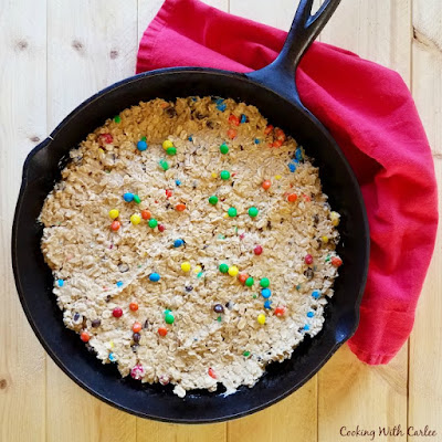 monster cookie dough pressed into skillet and ready to bake