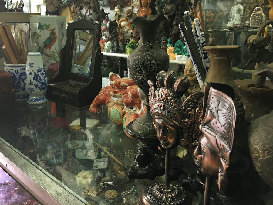 Mini statues at a dusty antique store in Malacca Malaysia
