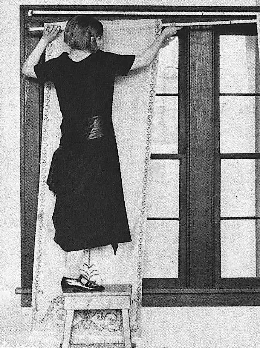 a 1925 catalog model demonstrating curtain hanging