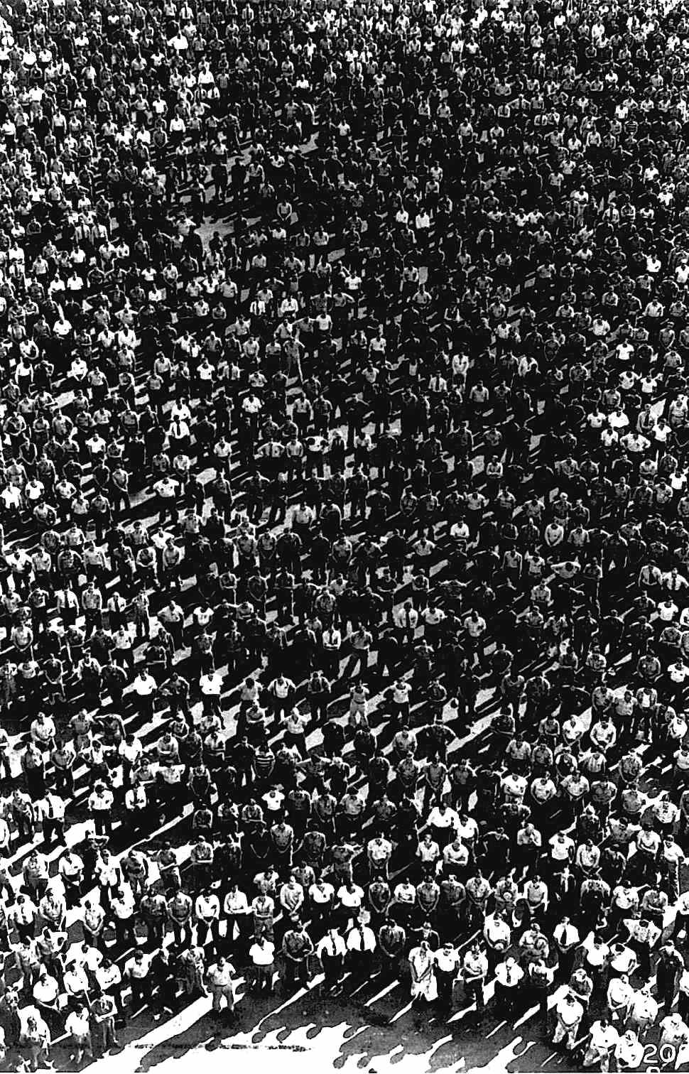 an anonymous 1942 aerial photograph of a crowd of men
