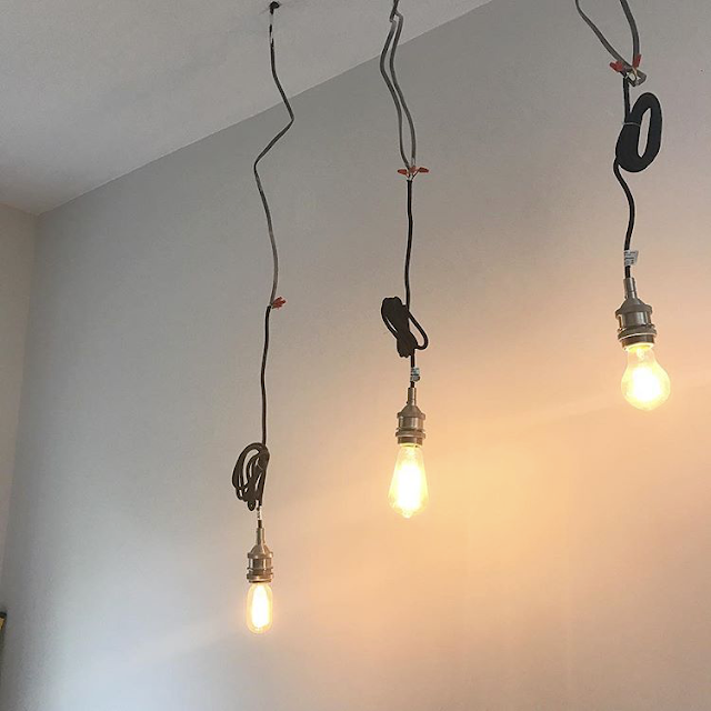 Industrial hanging light bulbs in kitchen