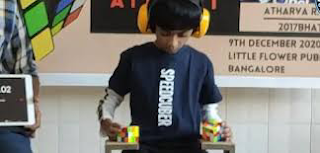 8-year-old uses hands and feet to break Rubik's cube world record