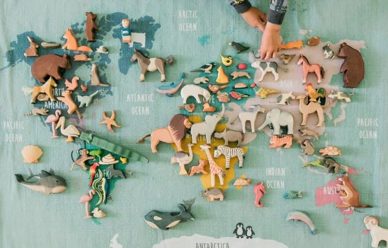 ostheimer wooden toys on a world map