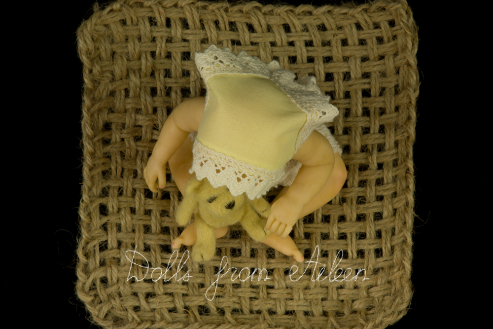 OOAK anatomically correct sitting baby girl doll seen from above