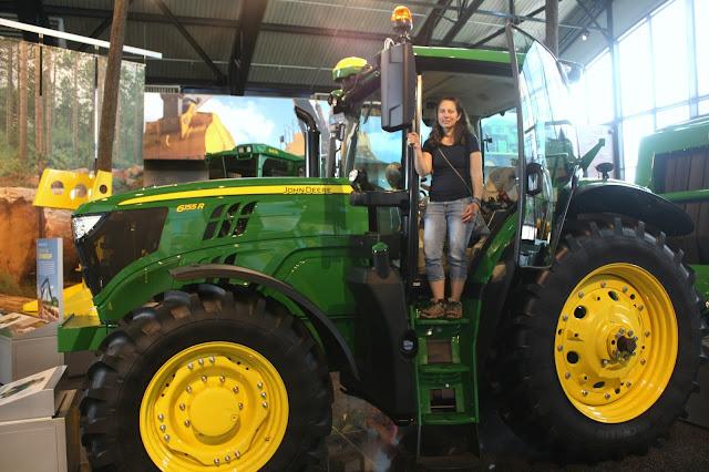 Climbing aboard a John Deere Tractor